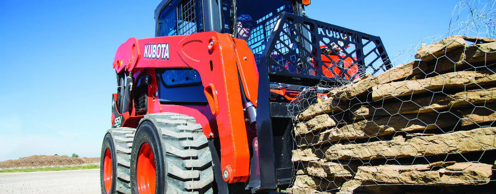 skid-steer tracks vs. tires